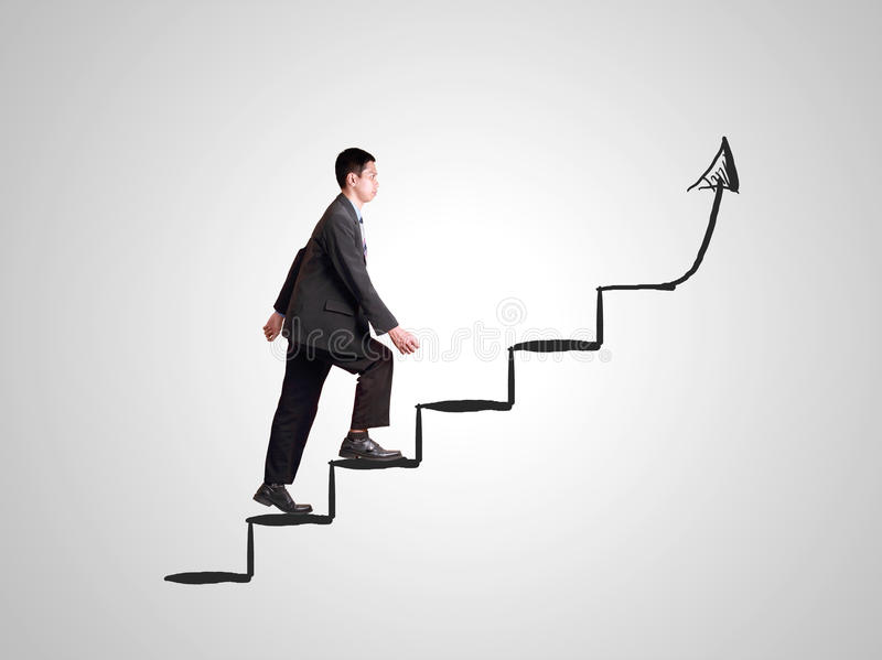 businessman walking on drawing stairs for success royalty
