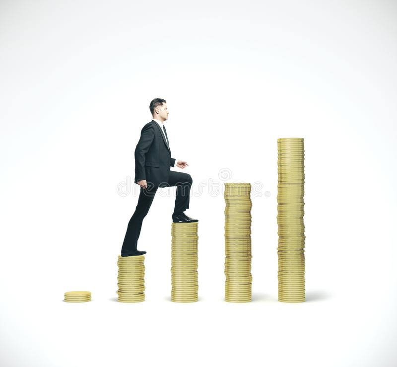 Businessman walking on gold coins chart. Businessman in suit walking on gold coins chart. Business success concept stock photos