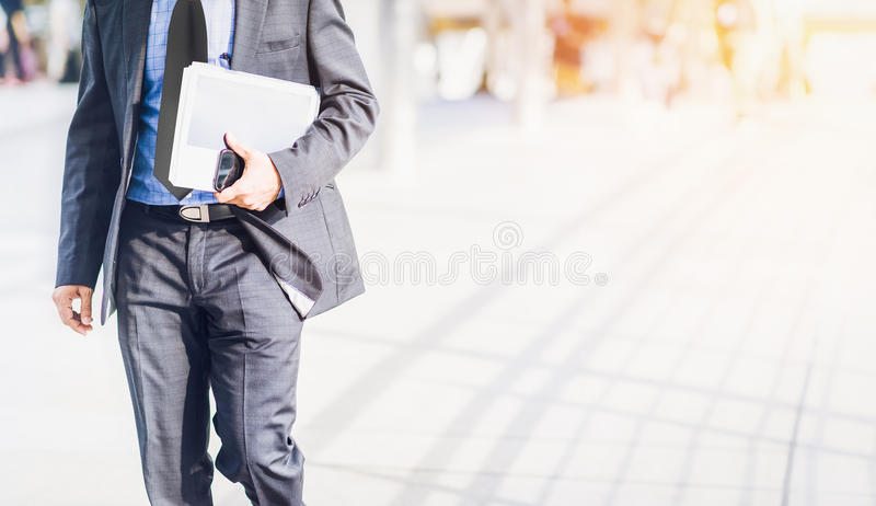 Businessman walking in a hurry. Hand on mobile royalty free stock images