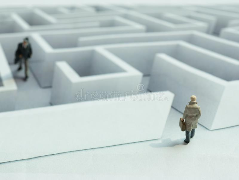 businessman walking into the maze illustrate to risk and direction concept stock photo