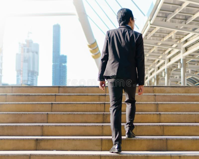 Businessman walking outdoor in the street footsteps stock photo