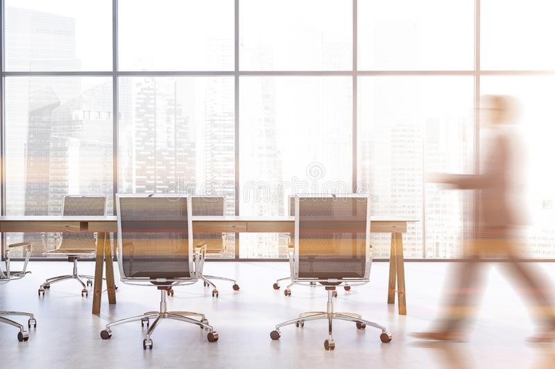 Businessman walking in panoramic conference room royalty free stock photos