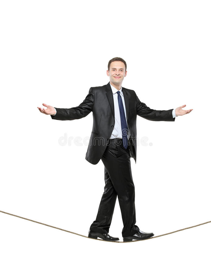Businessman walking on a rope stock photography