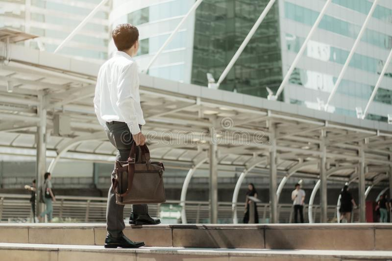 Businessman are walking with sunlight. stock photos