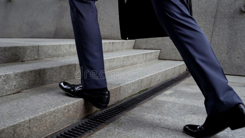 Businessman walking up stairs, success in career concept, promotion, closeup royalty free stock photos