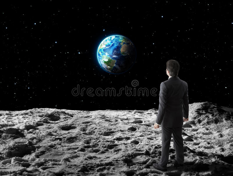 Businessman walks on moon stock photos
