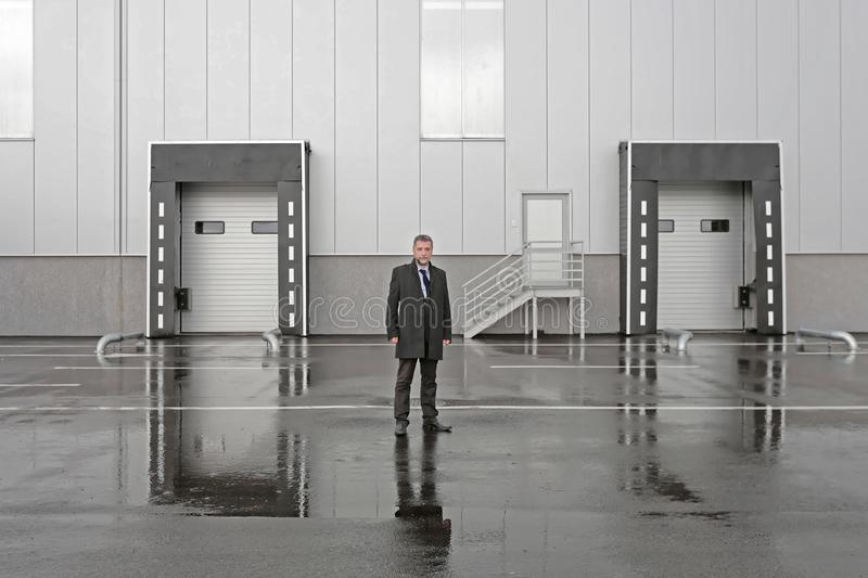 Businessman Warehouse Dock. Businessman in Front of Distribution Warehouse Loading Dock stock images