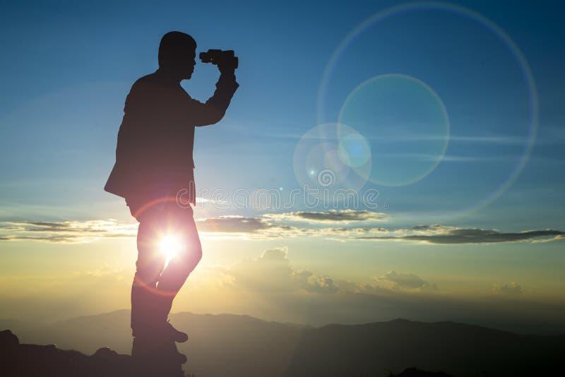 Businessman watch binoculars stock photos