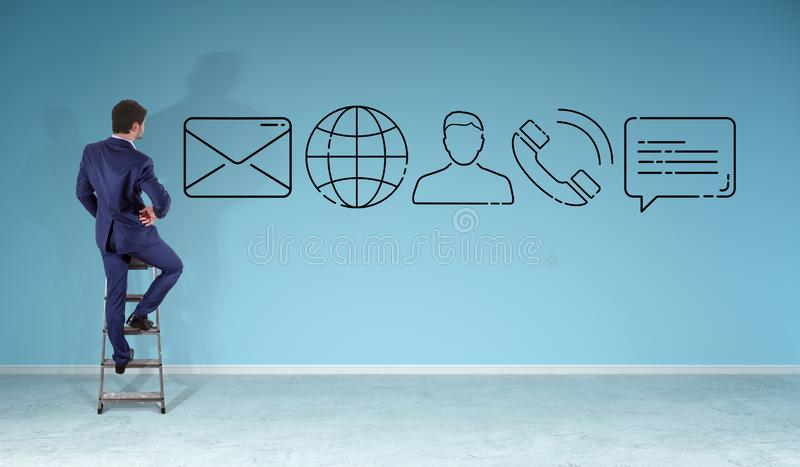 Businessman watching contact icon on a wall vector illustration
