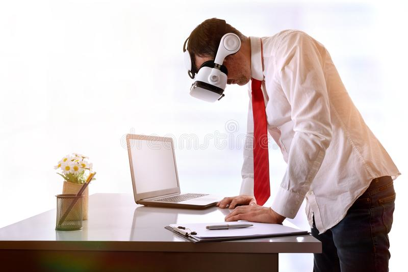 Businessman watching images of virtual reality on the table stock images