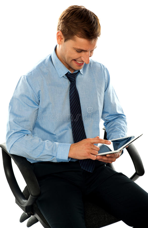 Download Businessman Watching Videos On Tablet Pc Stock Image - Image: 25261785
