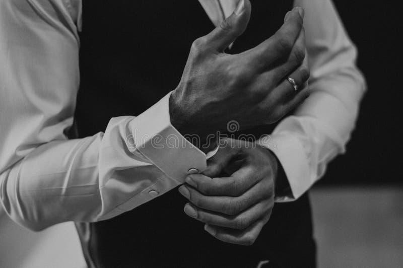 Businessman wear cufflinks. White clothes. Businessman wear cufflinks. White luxury clothes stock photography