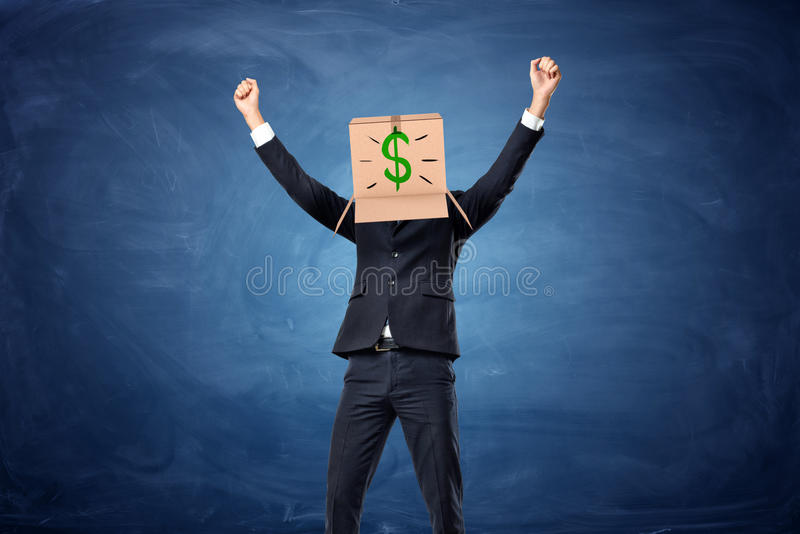 Businessman wearing cardboard box with drawn dollar sign on his head royalty free stock photo