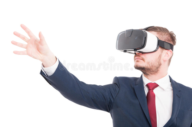 Businessman wearing 3d virtual reality glasses. And trying to catch something isolated on white background royalty free stock image