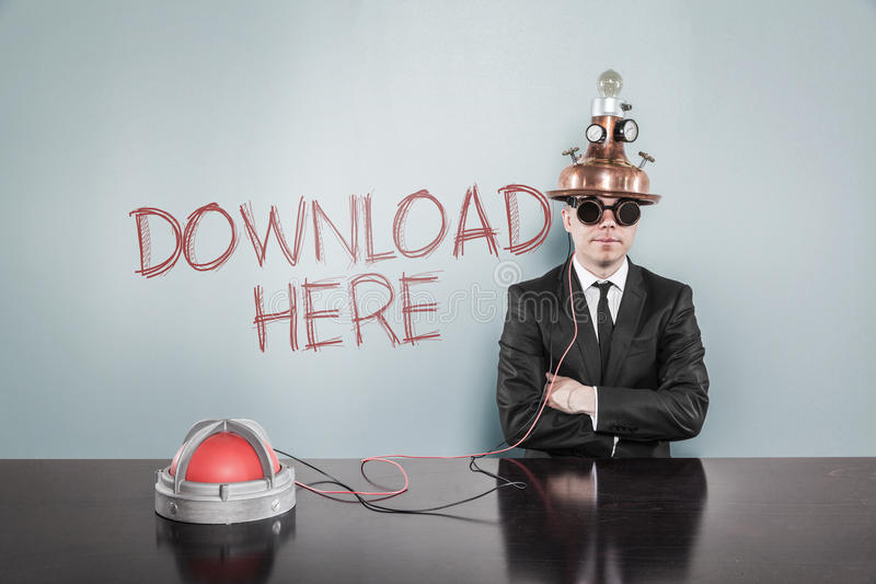 Businessman Wearing Futuristic Helmet By Download Here Text On Wall stock photo