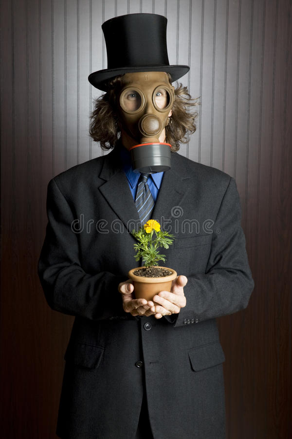 Businessman wearing a gas mask stock photos