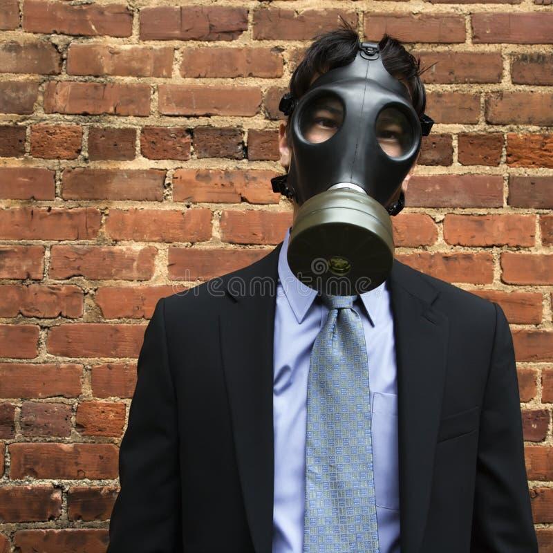 Businessman wearing gas mask. stock image