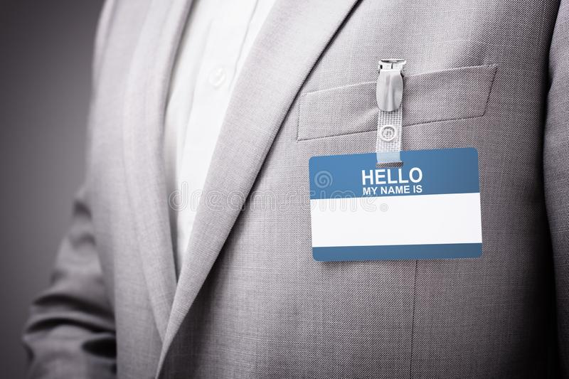 Businessman wearing Hello my name is tag stock photo