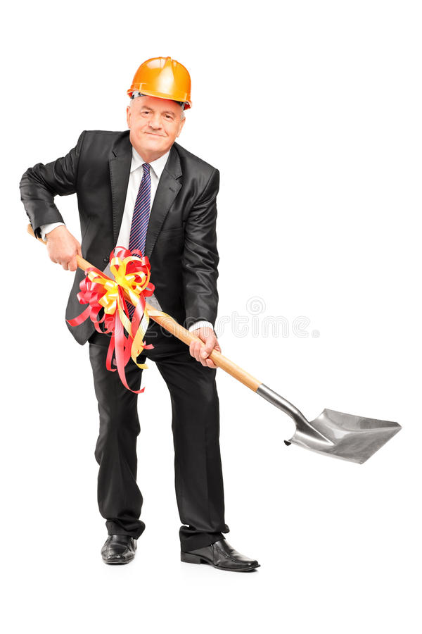 Download Businessman Wearing Helmet And Holding A Shovel With Ribbon Stock Image - Image: 28555891