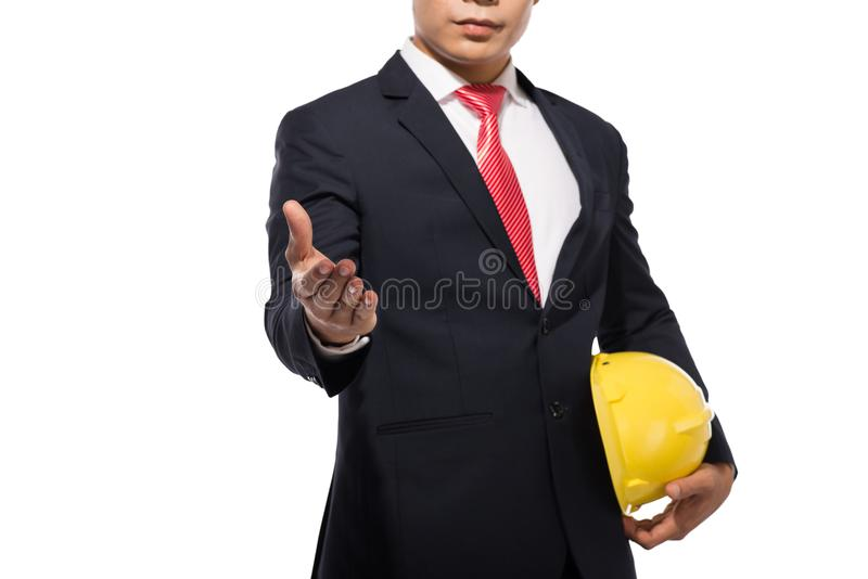Businessman wearing a helmet standing and reaching hand for hand. Shake, isolated on white stock photos