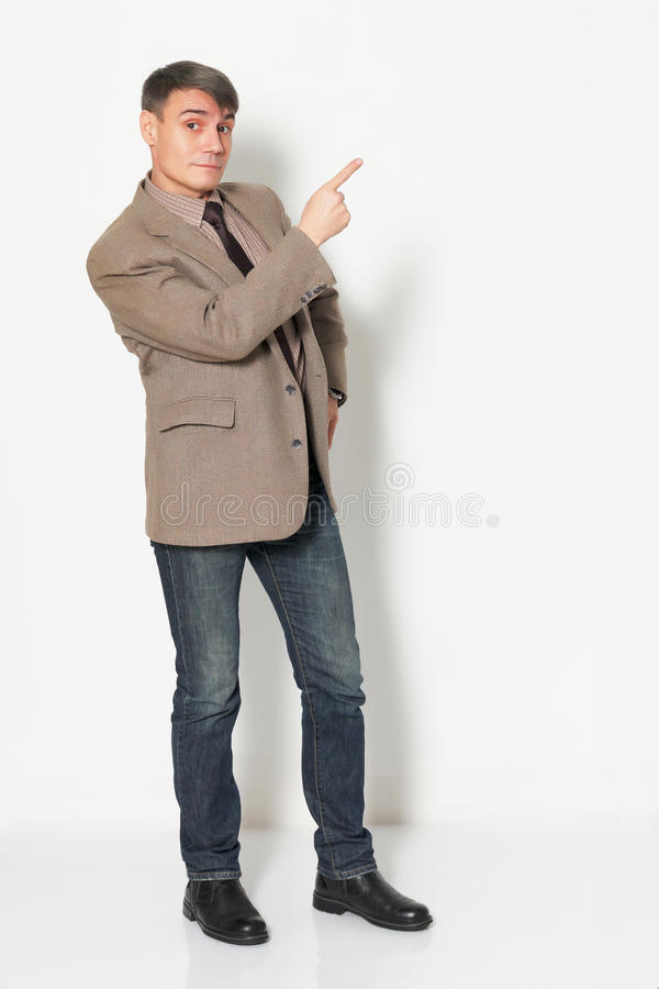 Businessman wearing a jacket shirt and jeans on light background royalty free stock image