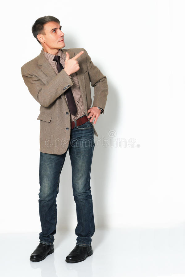 Businessman wearing a jacket shirt and jeans on light background royalty free stock photography