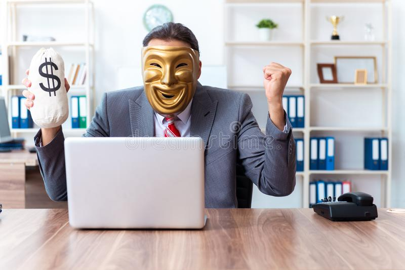 Businessman wearing mask in hypocrisy concept stock images