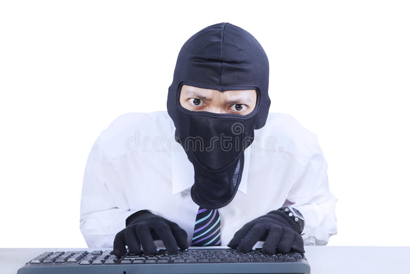 Businessman wearing mask stealing information stock photo