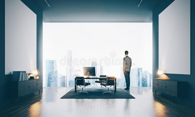 Businessman wearing modern suit and looking at the stock photography