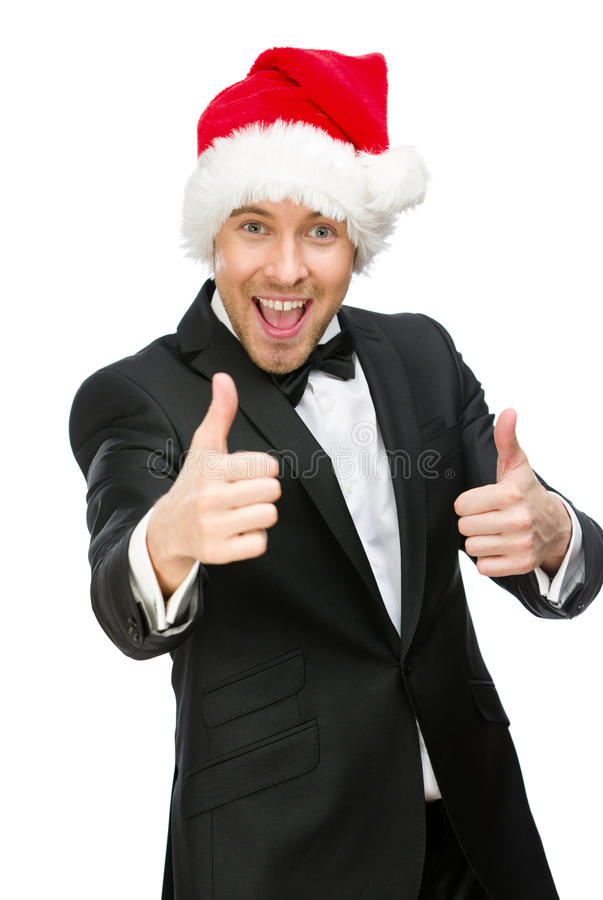Businessman wearing Santa Claus cap thumbs up royalty free stock images