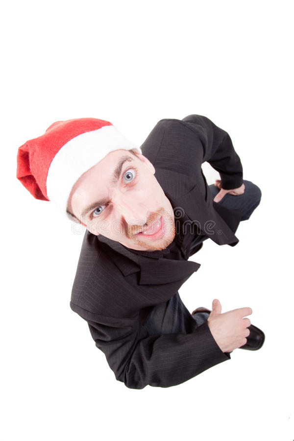 Businessman wearing santa hat. A businessman wearing santa hat stock photos
