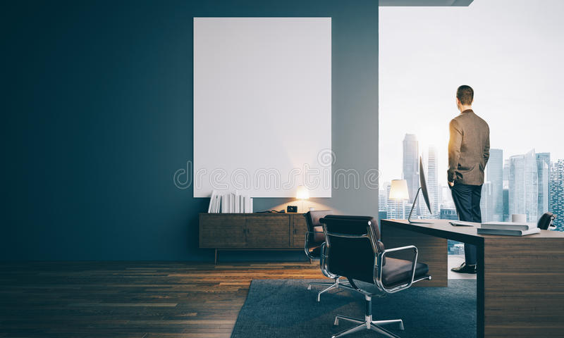Businessman wearing suit and looking at the city stock photo