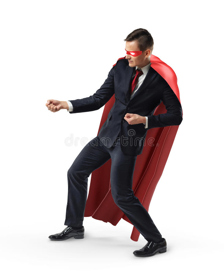 A businessman wearing a super hero mask and red cape holding an invisible rope. Business and competition. Development. Increasing sales royalty free stock image