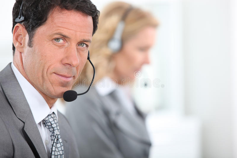 Download Businessman Wearing A Telephone Headset Royalty Free Stock Photos - Image: 25435658