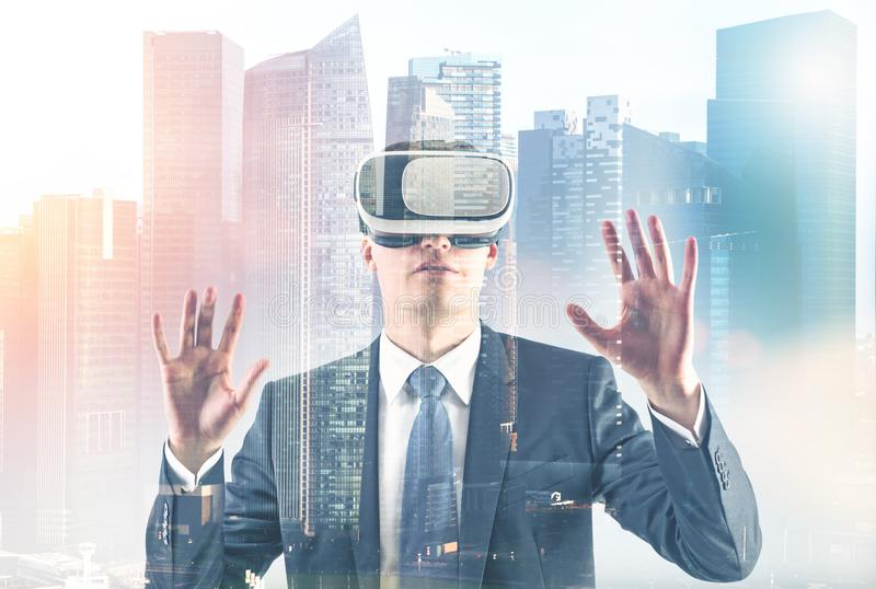 Businessman in VR glasses in a city royalty free stock image
