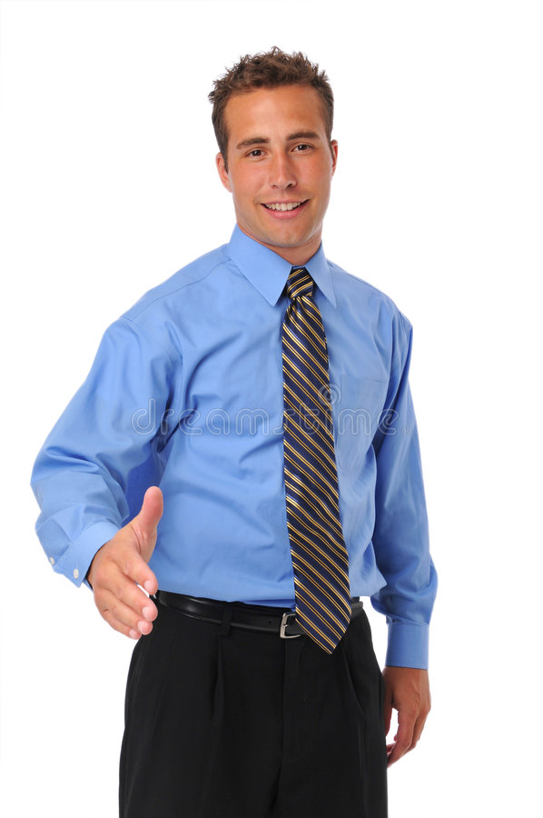 Businessman welcoming with extended hand stock image
