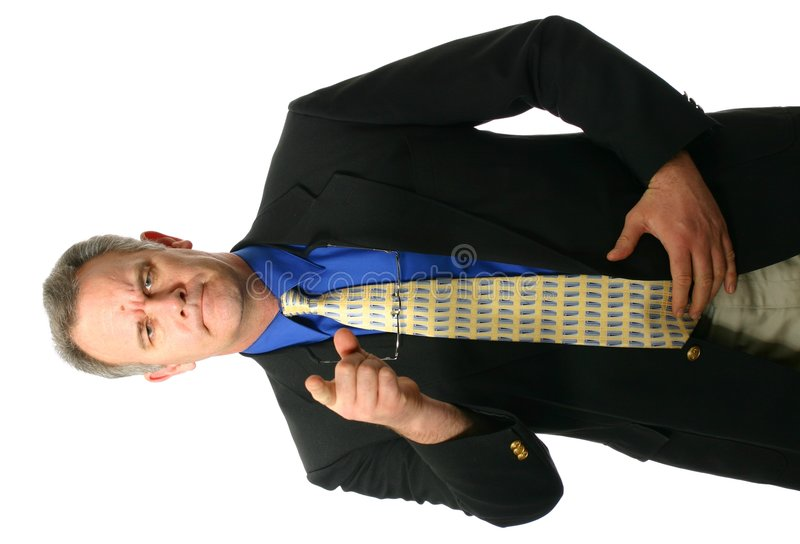 Businessman with welcoming gesture stock photo