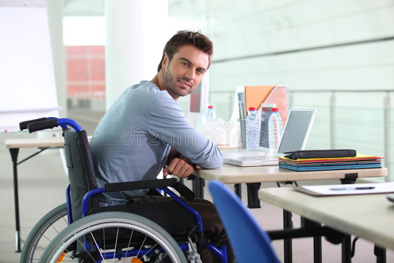Businessman in a wheelchair royalty free stock photos