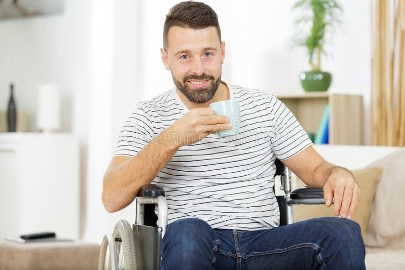 Businessman in wheelchair in office stock image