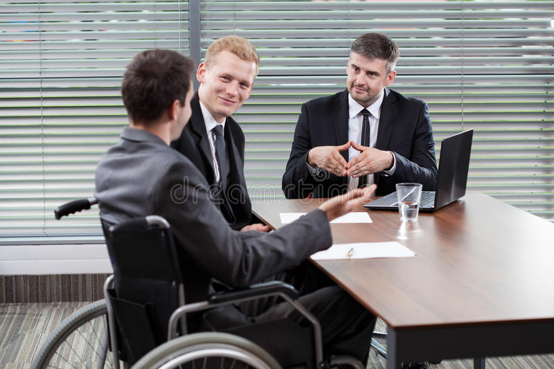 Businessman on a wheelchair stock images