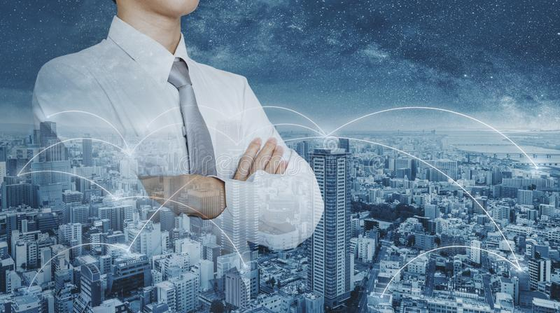 Businessman in white shirt, double exposure futuristic city networking royalty free stock image
