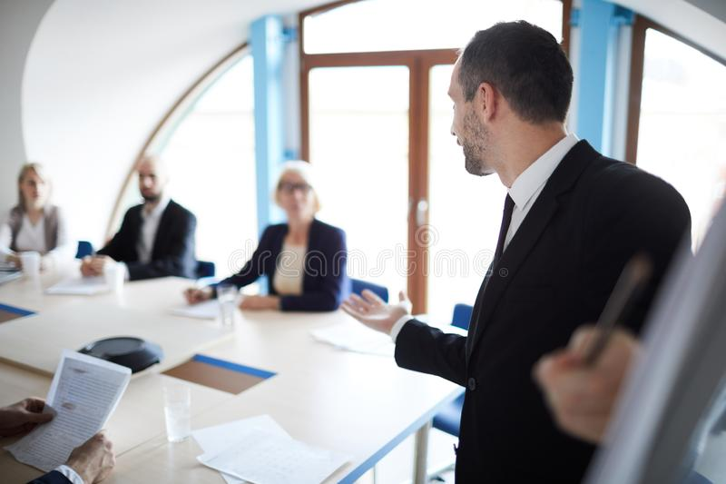 Businessman by whiteboard stock photography