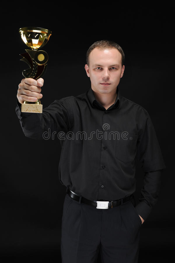 Businessman With Win Cup In Hand Stock Photo