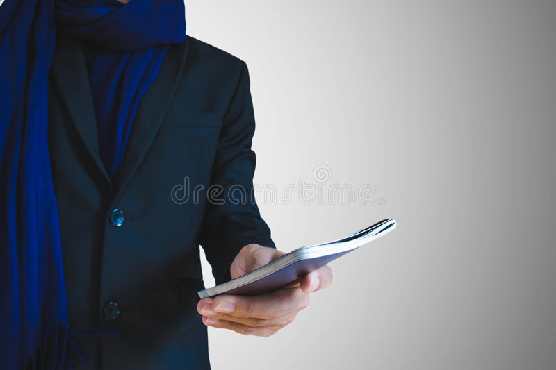 Businessman in winter suit with passport or ID card on hand, selective focus on hand stock photos