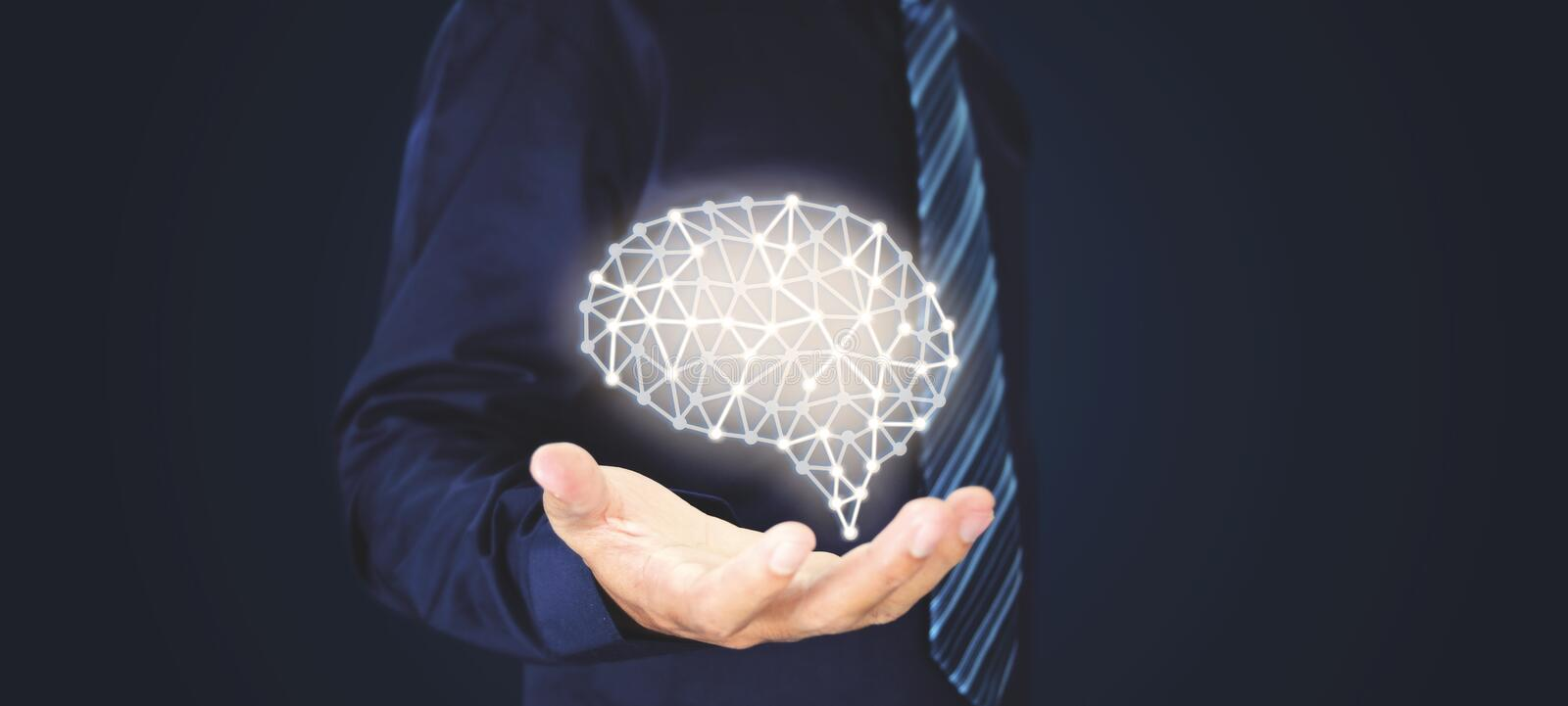 Businessman with wire frame hand holding abstract brain. Structure stock photos