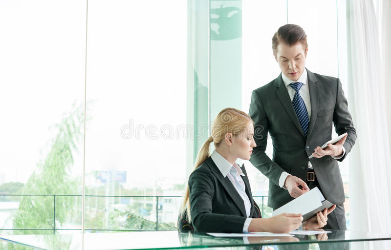 Businessman and woman discussing stock photography