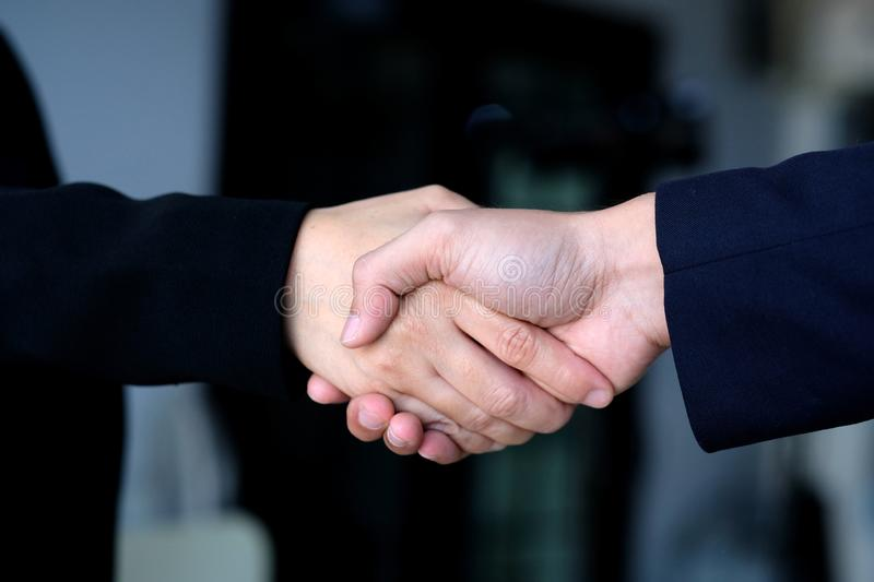 Businessman and woman handshake at office, business cooperation, success in business concept royalty free stock image