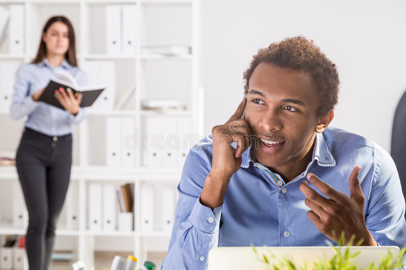 Businessman and woman in office stock photos