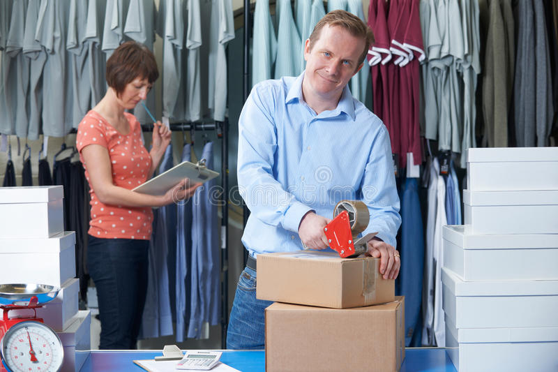 Businessman And Woman Running Online Clothing Company royalty free stock photo