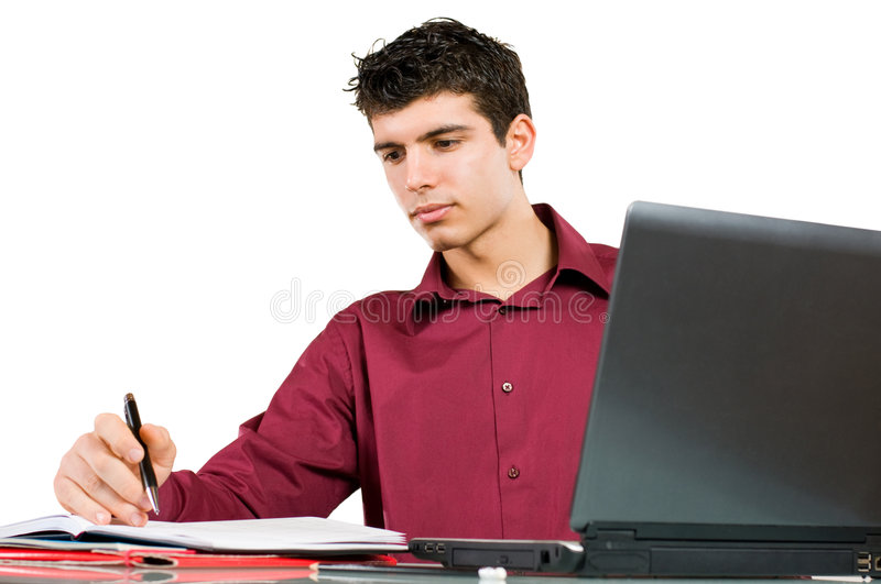 Businessman at work. Young busy man studying and working on his laptop with note pad isolated on white background royalty free stock image